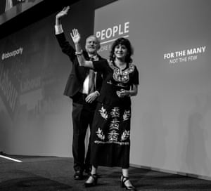 Corbyn and Alvarez wave to the conference audience