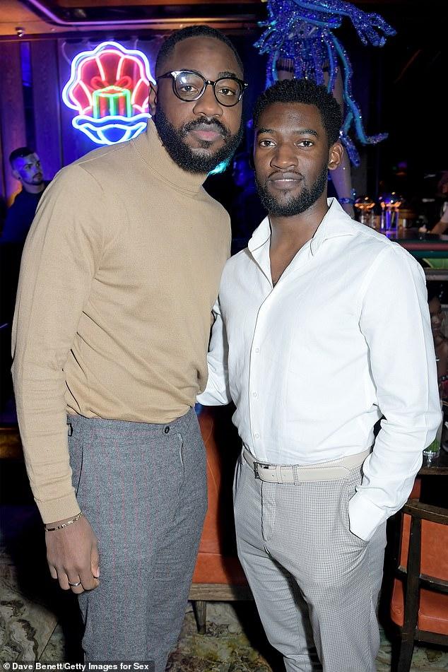 Looking sharp: Black Mirror star Malachi Kirby enjoying the event alongsideTayo Adebiyi (left)