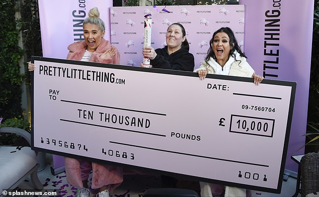 Lucky winners: The star giggled with the surprised winner of Laura as she handed her a giant cheque for £10,000