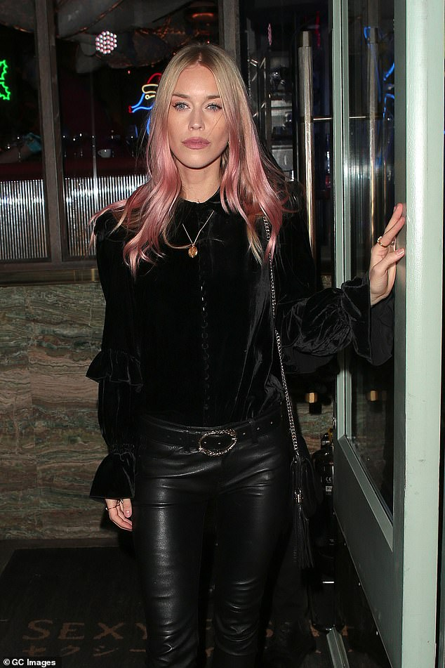 Pretty in Pink: Fashion model, DJ and musician Lady Mary Charteris had her pink tipped blonde locks on display against her all black number