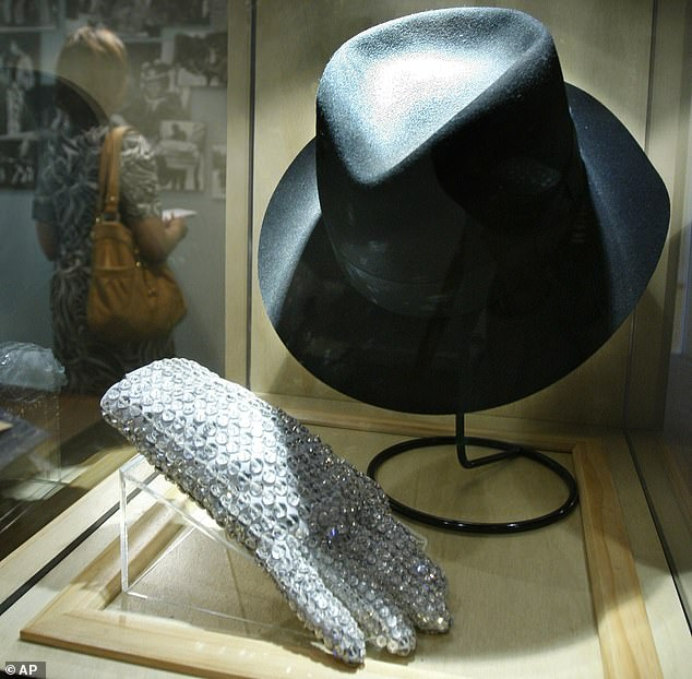 The King of Pop's wares: Michael Jackson's famed sequined glove, along with fedora, on displayat the Motown Historical Museum in Hitsville U.S.A. in Detroit, Michigan in 2010