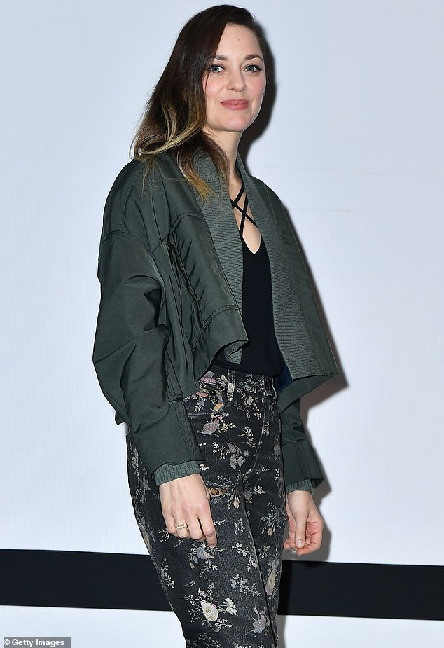 Looking good: The actress donned an edgy khaki green bomber jacket which was cropped at the front so not to look oversized on her petite frame