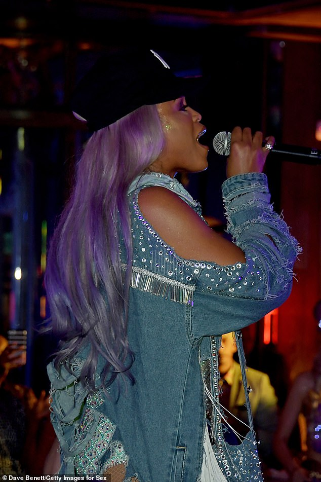 Shine bright: The American singer rocked an ombre purple hair do keeping with the pastel colour theme