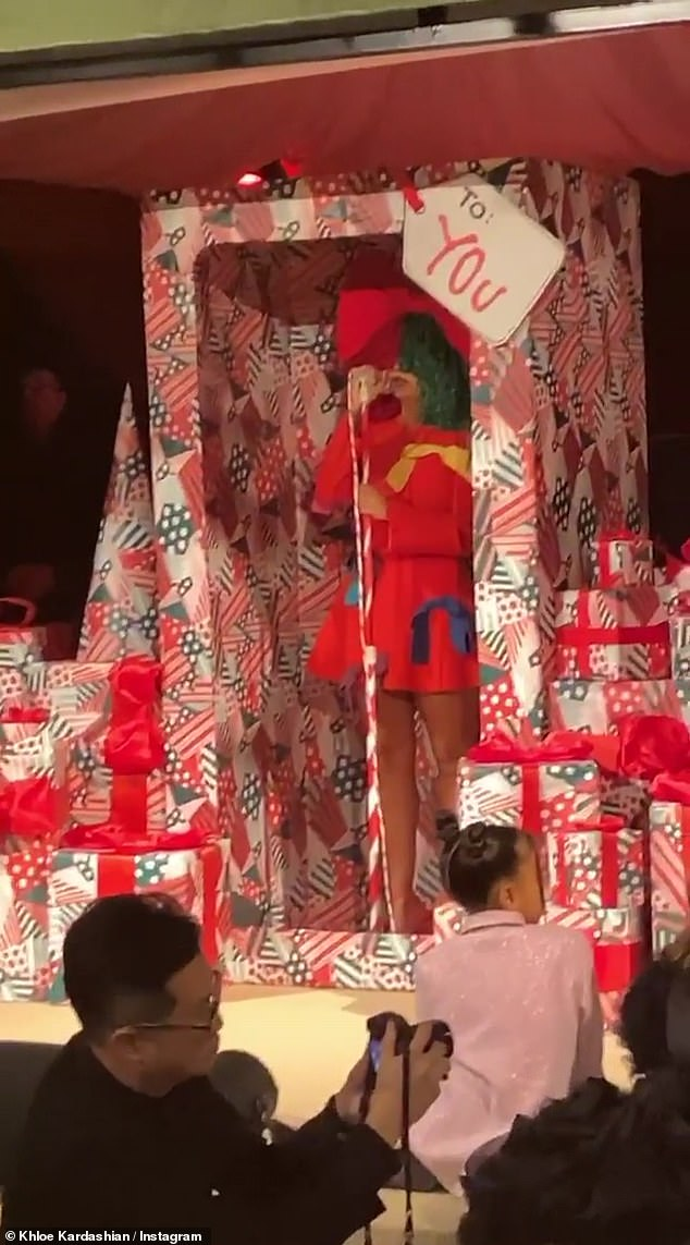 Surprise: Recording artist Sia (real name Sia Kate Isobelle Furler), 44, delivered a surprise performance at the party, while inside a life-sized gift box.