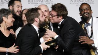 Writer Fabio Porchat (2-R) poses with the Especial de Natal Porta dos Fundo team in celebration of their best comedy award win during the 47th International Emmy Awards gala at the New York Hilton hotel