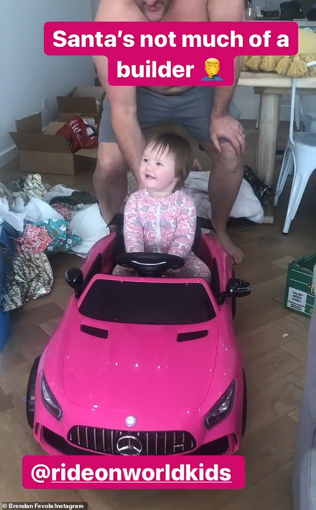 'Santa's not much of a builder': Brendan Fevola's daughter Tobi, one, received a toy convertible on Christmas Day, on Wednesday