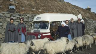 Call the Midwife characters surrounded by sheep