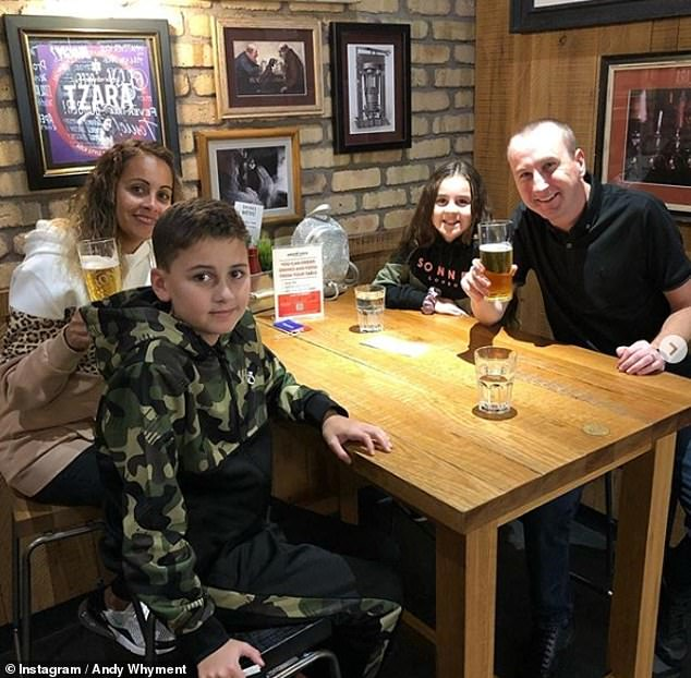 Exciting:Coronation Street's Andy Whyment has jetted to Dubai with his wife Nichola and their two children for New Year, as he shared a snap of the family enjoying a pre-flight drink