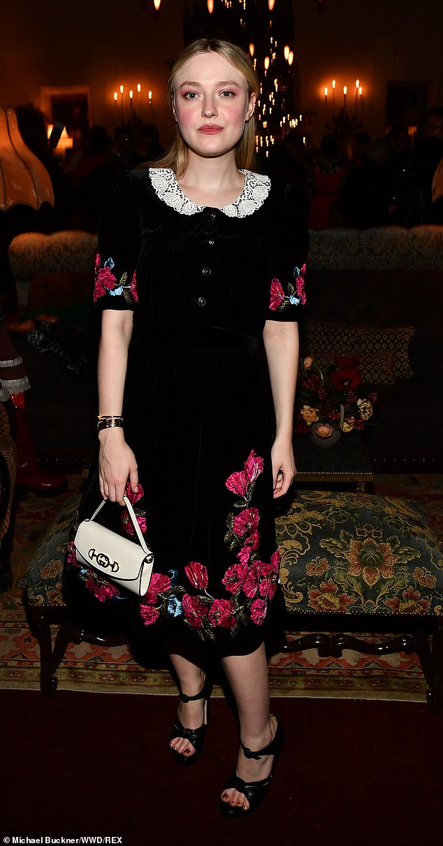 Stylish: Dakota Fanning attended a book party at West Hollywood's Chateau Marmont on Tuesday night wearing a pretty black dress with white lace collar and red floral motifs