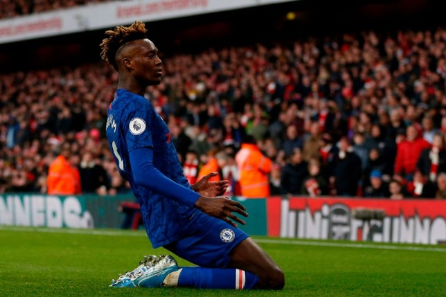Tammy Abraham slides on his knees like Didier Drogba celebrating a goal for Chelsea