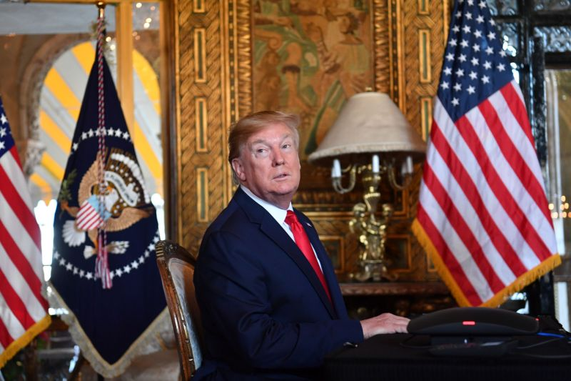Donald Trump answers questions from reporters on December 24, 2019. (Photo by Nicholas Kamm/AFP via Getty Images)