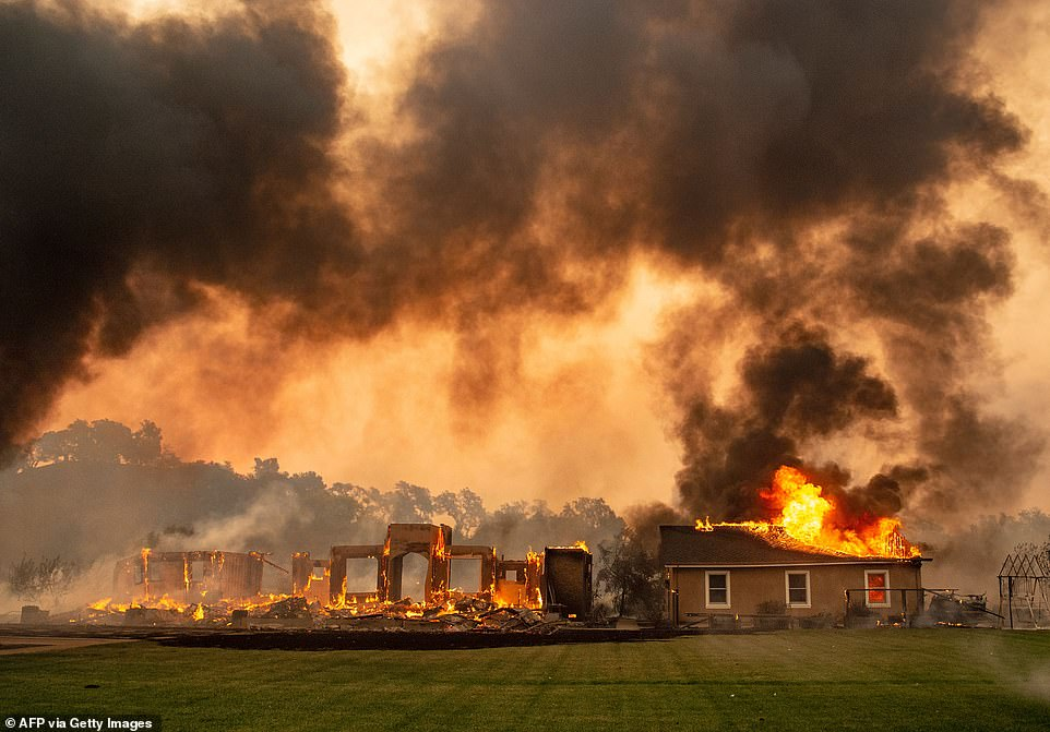 Climate change-related extreme weather cost more than £107.4billion last year and killed 4,572 people, according to a landmark report by Christian Aid. The most costly event was the wildfires in California (pictured above) which ripped through the area after eight years of drought