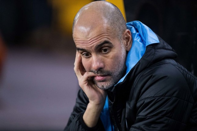 Pep Guardiola looks on during Manchester City's defeat to Wolverhampton Wanderers in the Premier League