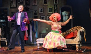 A hymn to self-belief … Simon Burke as Georges with John Barrowman, who took over the role of Albin in the Playhouse production of La Cage aux Folles.
