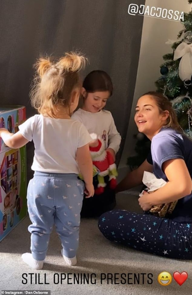 Lavish:Jacqueline Jossa's husband Dan Osborne has revealed that their daughters Ella, four, and Mia, 18 months, are still opening their presents four days after Christmas