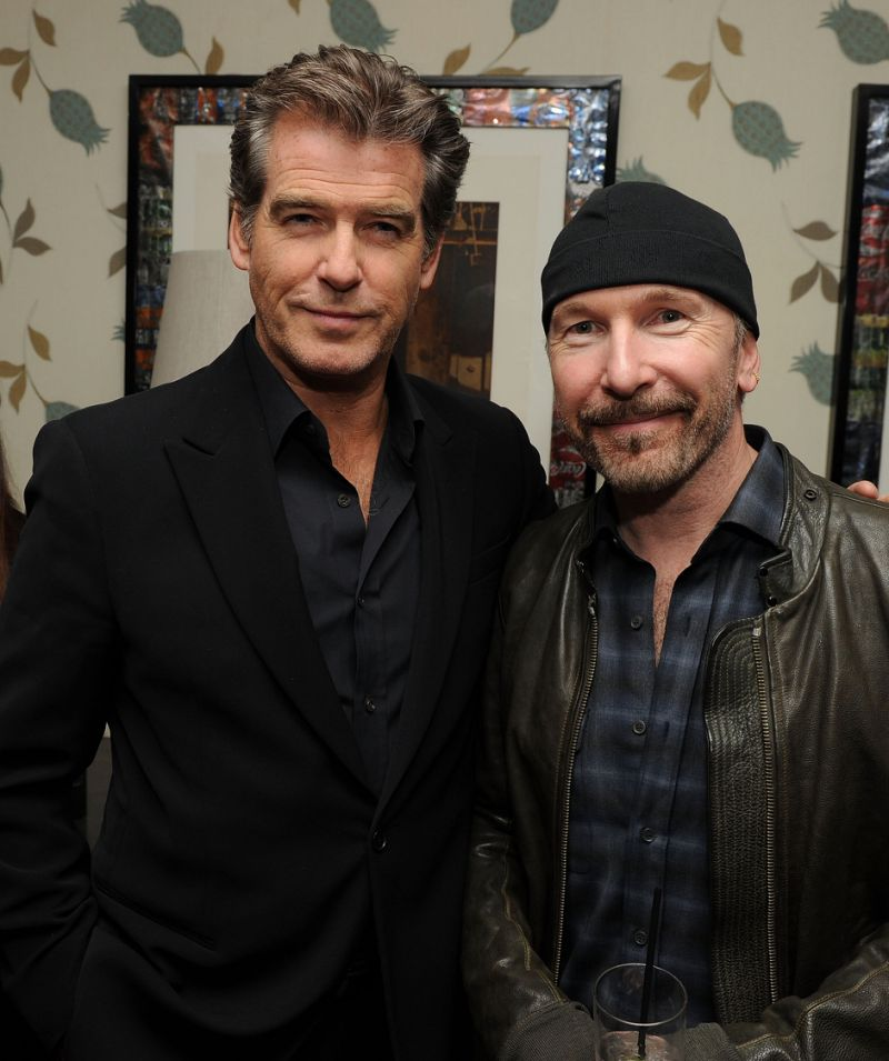 "NEW YORK - FEBRUARY 18: Actor Pierce Brosnan and musician The Edge of U2 attend the after party for the Cinema Society & Screenvision screening of ""The Ghost Writer"" at the Crosby Street Hotel on February 18, 2010 in New York City. (Photo by Stephen Lovekin/Getty Images)"