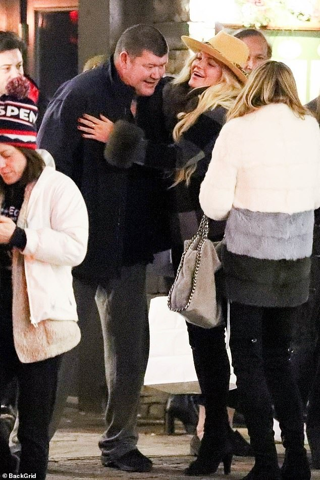 Playing around: James Packer (pictured left) showed off his softer side during an interaction with a female friend in Aspen, Colorado earlier this month