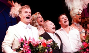 Jerry Herman, centre in black suit, with the cast of La Cage aux Folles in 2010.