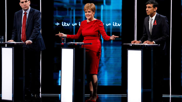 SNP leader and Scottish First Minister Nicola Sturgeon gestures next to Labour Party's Richard Bergen and Conservatives' Chief Secretary to the Treasury Rishi Sunak during an election debate in London, Britain December 1, 2019. Matt Frost/ITV/Handout via REUTERS THIS IMAGE HAS BEEN SUPPLIED BY A THIRD PARTY. NO RESALES. NO ARCHIVES. PICTURE AVAILABLE FOR USE ONLY UNTIL DECEMBER 19TH 2019.