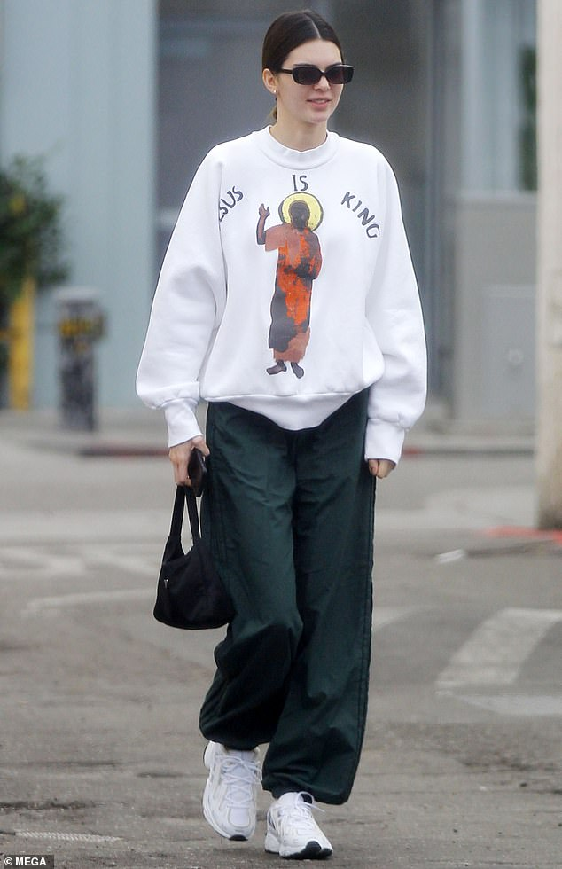 Christian girl: Kendall Jenner rocked a 'Jesus Is King' sweatshirt Sunday as she stepped out on the one-year anniversary of brother-in-law Kanye West's Sunday Service