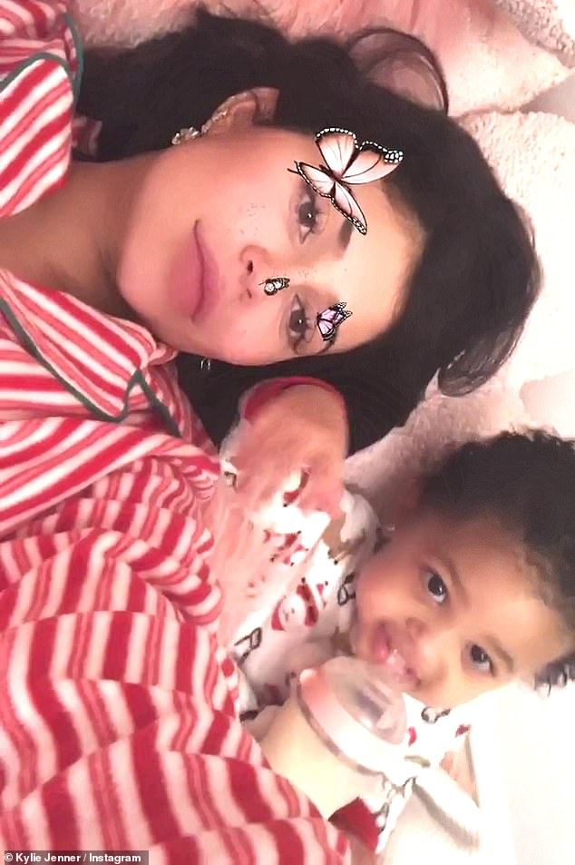 She raked it in: Kylie Jenner seems to have cleaned up on Christmas morning. The billionaire took to her Instagram Stories to show off her loot. Here she is seen with Stormi