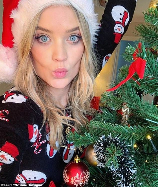 Festive FaceTime: Laura stayed in touch with boyfriend Iain Stirling over FaceTime on Christmas Day
