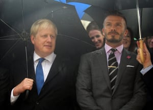 Boris Johnson, then London's mayor, attends the Olympic flame ceremony in Athens alongside David Beckham in 2012.