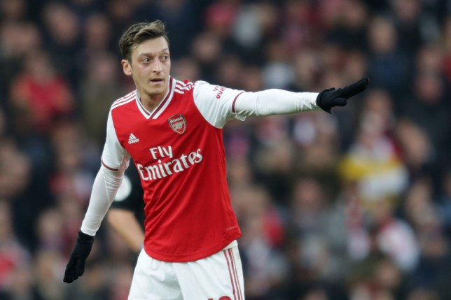 Mesut Ozil issues orders to his Arsenal team-mates during a game
