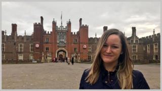 Angela Jansen outside Hampton Court Palace