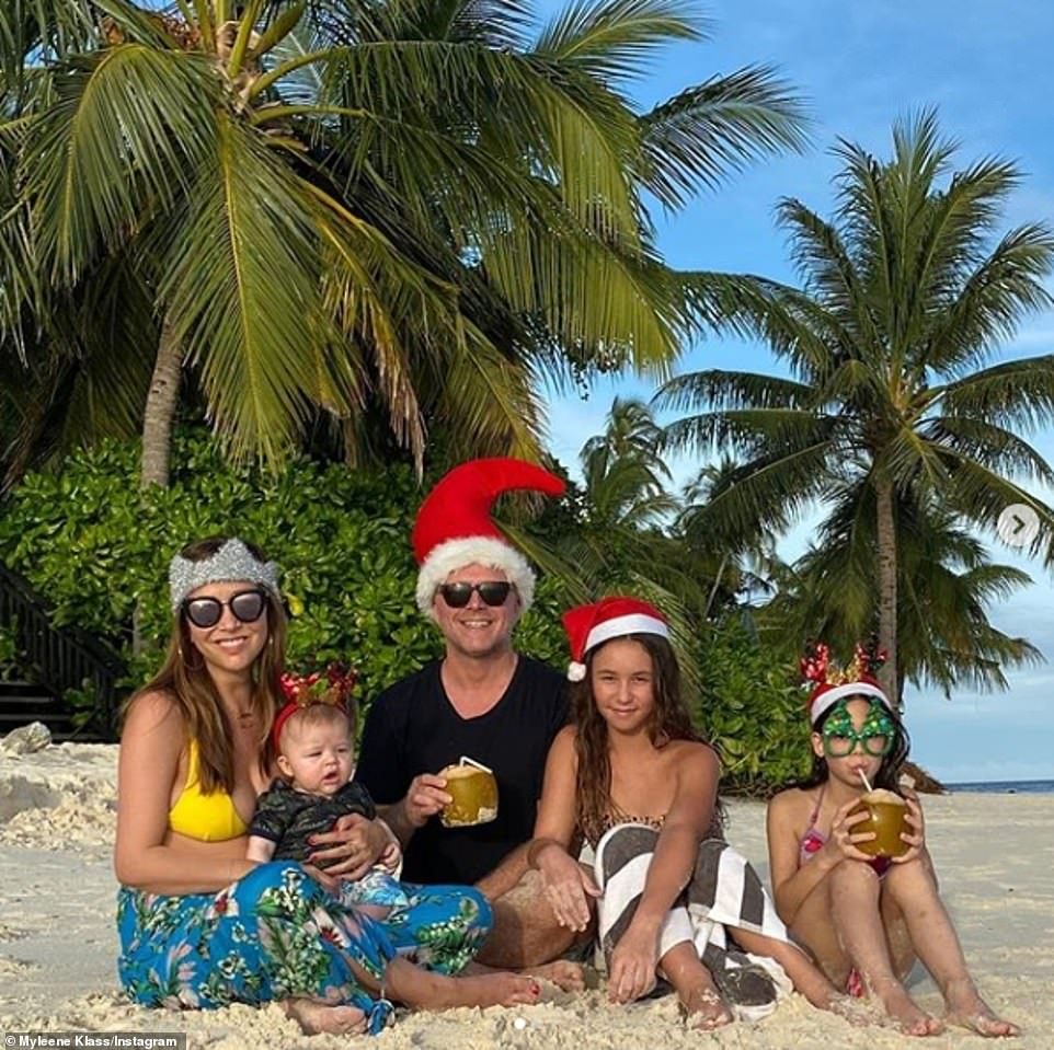 Christmas in style!Myleene Klass is seeing out 2019 in style during an idyllic Maldives family holiday as she led the stars sharing Christmas Day photos to Instagram on Wednesday (pictured with baby son Apollo, four-months, daughters Ava, 12, and Hero, eight, and partner Simon)