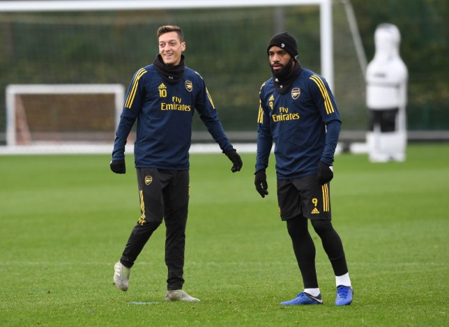 Mesut Ozil and Alexandre Lacazette