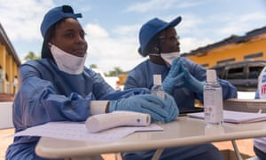 Nurses prepare to administer Ebola vaccine in Mbandaka in the Democratic Republic of Congo.