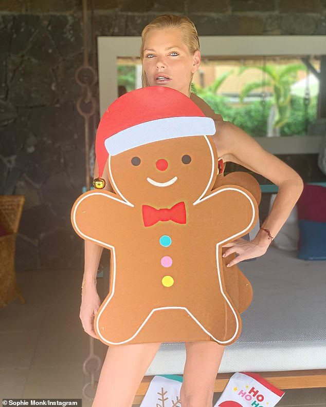 Getting into the spirit! Sophie Monk, 40, celebrated Christmas in Mauritius by dressing in aKmart gingerbread man costume