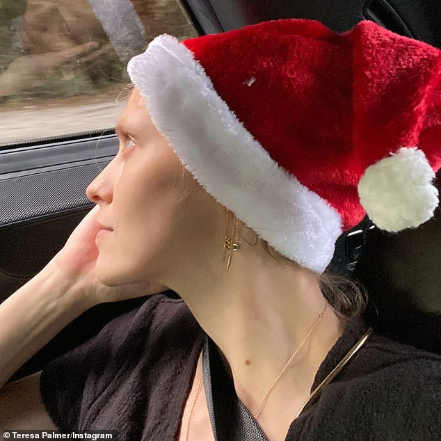 'How-to-not-ruin-xmas': Teresa Palmer (above) was forced to decorate a hotel room for Christmas after 'unforeseen visa issues' complicate family holiday plans