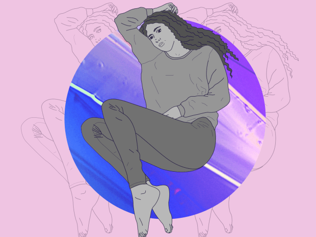 A woman lying down looking anxious