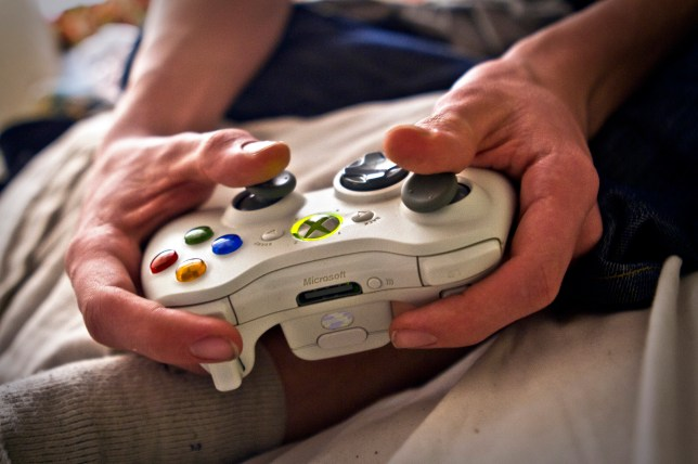 A man holding a computer games controller
