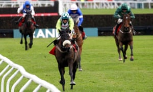 Cyrname (blue colours) finishing second behind Clan Des Obeaux in theKing George at Kempton.