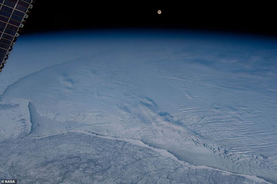 A wintry scene of icy shorelines and froze landscapes was captured from 254 miles above Earth. NASA astronaut aboard the International Space Station snapped a stunning image of a full moon rising over the Hudson Bay in northern Canada