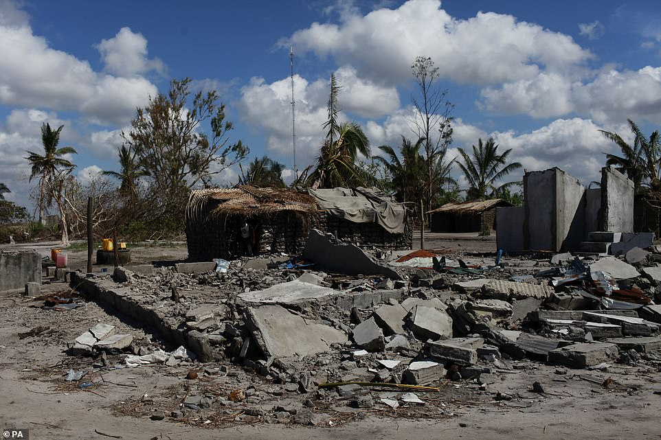 Rubble lies on the street after Cyclone Idai hits the African continent and causes damage in Mozambique (pictured), Zimbabwe, and Malawi