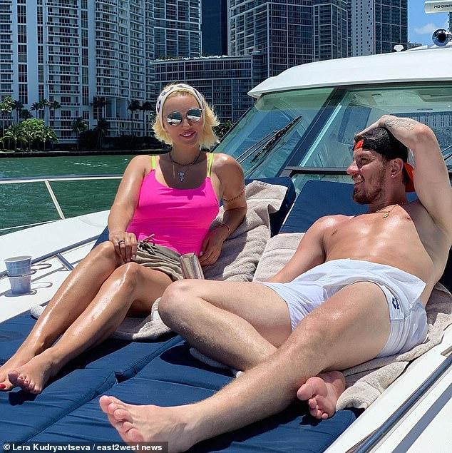 Miss Kudryavtseva is pictured with her ice hockey star husband Igor Makarov