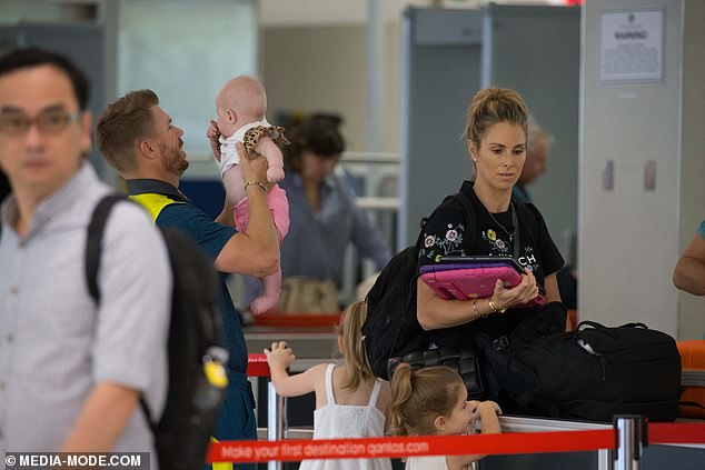 Homeward bound: David and Candice have been married since 2015 and are based in Sydney, but spent Christmas in Melbourne for the Boxing Day Test at the MCG