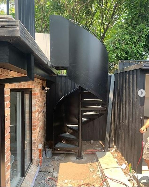 'Installed in record time': A black heritage spiral staircase on the exterior of the property was also completed as the couple started to get settled in December