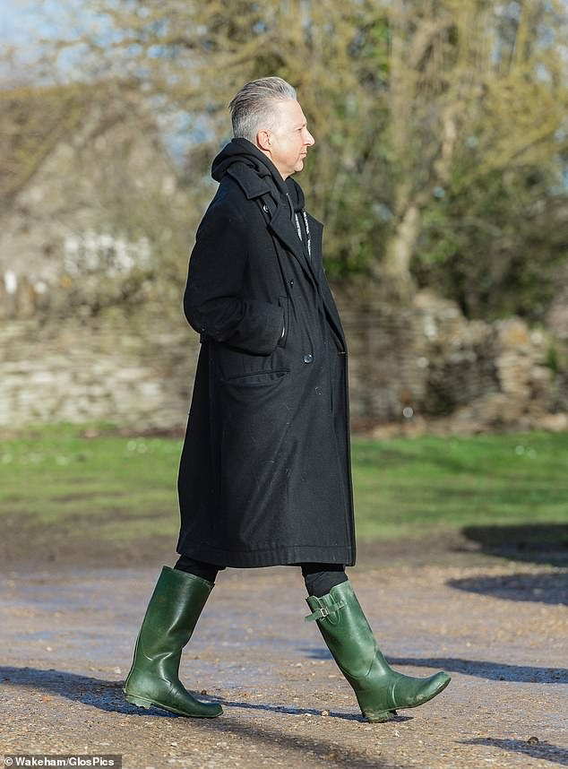 In his element: Publisher Jefferson stood out in his pair of dark green knee-high boots