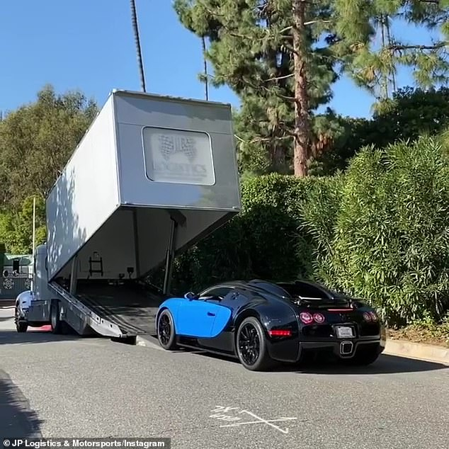 Special delivery:The dealer delivered the vehicle in a a very particular type of truck that conceals the car from all sides to prevent risk of damage during transportation