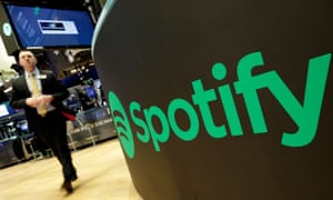 A trading post sports the Spotify logo on the floor of the New York Stock Exchange. Spotify, the No. 1 music streaming service which has drawn comparisons to Netflix, is about to find out how it plays on the stock market in an unusual IPO.