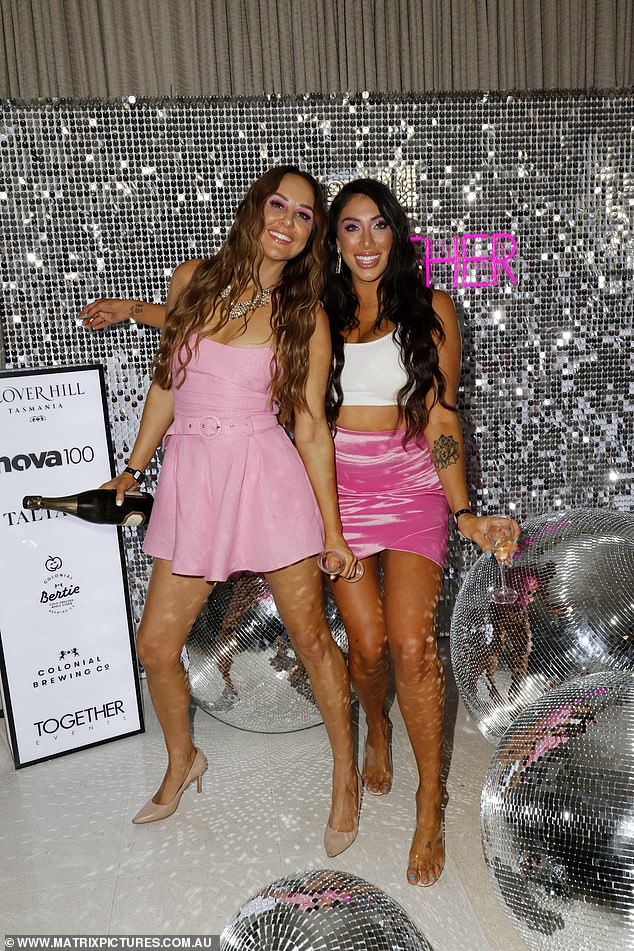 Standing out!Melissa (pictured left) meanwhile opted for a pink flowing minidress