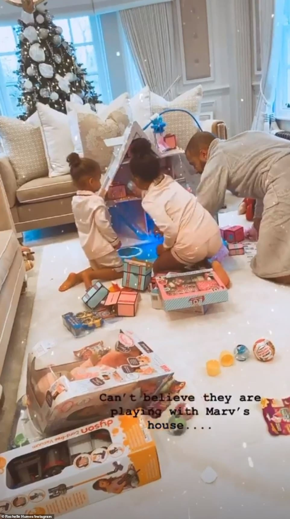So cute:Rochelle Humes shared a sweet video of her daughtersAlaia-Mai, six, andValentina Raine, two, playing with their toys with husbandMarvin Humes