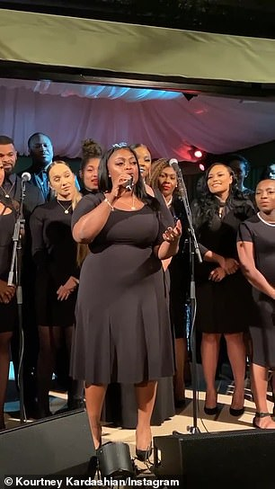 Black-clad choir: The choir belted and harmonized to Christmas chestnuts like Gloria in excelsis Deo and The Christmas Song