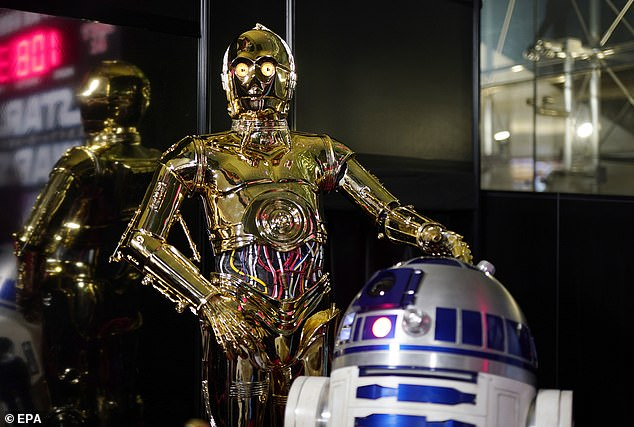 Incredible: The epic conclusion, which stars Daisy Ridley, John Boyega and Adam Driver, brought in $32million (£24million) on Chrstmas Day (pictured: C-3PO and R2-D2)