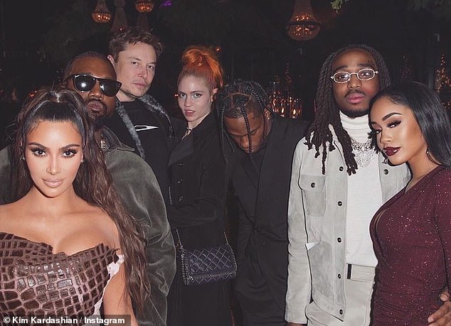 Hip-hop reality: Travis attended the Kardashians annual Christmas bash where he partied with Kylie's older half-sister Kim Kardashian and husband Kanye West as well as Elon Musk, Grimes, Quavo and Saweetie